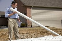 PVC utility pipes are often laid through a yard in a straight line.