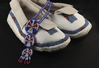 Beading on moccasins can be as simple as a rosette or can cover the entire shoe.