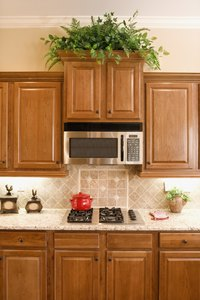 Crown molding provides a facelift for boring cabinets.