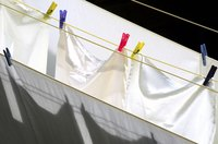 Hang bed linens outside to dry for a fresh smell without the use of waxy softeners.