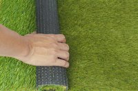 Artificial turf rolled out by hand