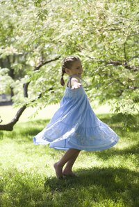 Sundresses often have smocked bodices that flare into full skirts.