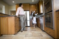Kitchen cabinets can frame your refrigerator for a neat, finished decor.