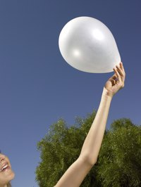 Use white balloons to create a wall full of underwater bubbles.