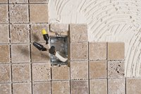 Safety is key when grouting around an electrical outlet.
