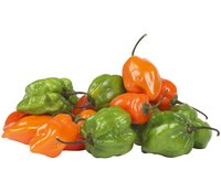Aji dulce peppers start in green but age to orange.