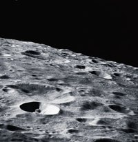 Pictures of the moon can be used to sculpt the details on a papier mache model.
