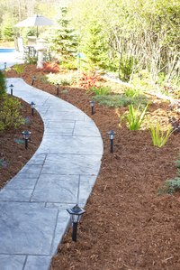 Customize your walkway by combining materials such as mulch and pavers.