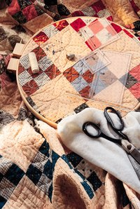 A quilting frame replaces the traditional quilting hoop.