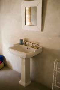 Pedestal sinks provide the illusion of additional floor space.