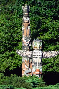 Totem poles can include birds with expanded wings.
