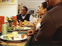 A family shares ideas during a Thanksgiving dinner.
