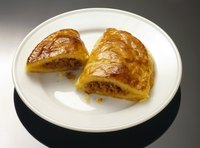 You can consider pastelitos miniature empanadas that use pastry dough instead of yeast dough.