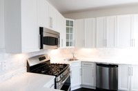 A fresh coat of paint improves the appearance of laminate cabinets.