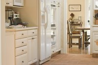 You can paint kitchen cabinets to match or contrast with kitchen appliances.