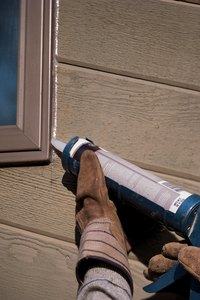 Reduce your electric bill by reducing indoor air leaks with trim caulking.