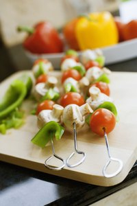 Skewer raw meat and veggies separately to prevent cross-contamination.