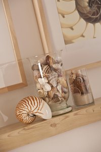 Seashell and sand jar crafts make charming home decor.