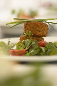 Garnish crab cakes with greens such as chives, or parsley.