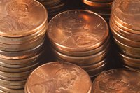 Stacks of copper pennies have a red-pink color.