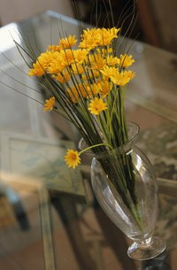 A waterless glass vase is a tip-off that the flowers are fake.