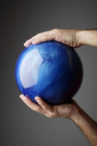Cover a bowling ball with glass to create a piece of garden art