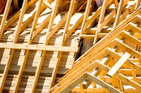 Close-up of exposed wooden planks on a house roof under construction
