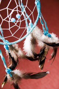 Learn how to make a dream catcher with a Native American spider web design.
