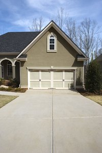 Concrete driveways should be painted to prevent further cracking.