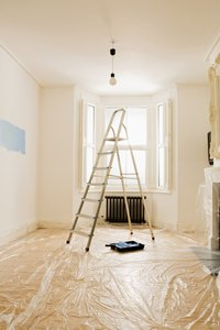 Use a sanding sponge and a new coat of paint to get rid of roller marks in your ceiling.
