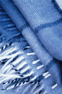 Winter scarves often have fringed ends that match the colors of the scarf.