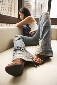 Jeans can be fashionably distressed for everyday wear.
