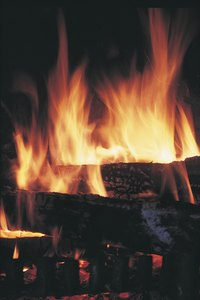 Break up green, or unseasoned, wood to improve its ability to burn.