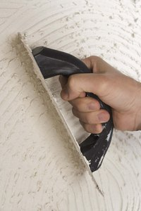 Apply Grout Enhancer with a rubber float.