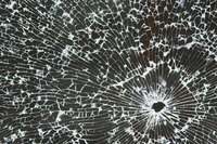 Sheet glass is replaced for all kinds of reasons, including bullet holes.