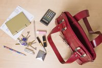 Keep small items, such as lipstick, in a secure spot inside your purse.