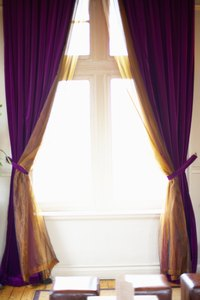 Visually change the size of your windows with curtains.