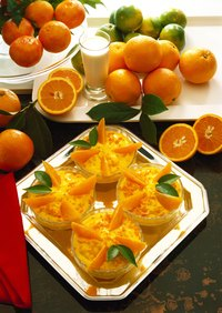 The arrangement of oranges will vary along with the additional types of fruits and vegetables you are serving.