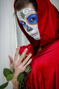 Use white face paint in different makeup designs.