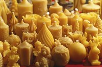 An assortment of homemade beeswax candles.