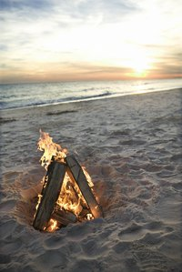 The wind can make building a beach fire difficult.
