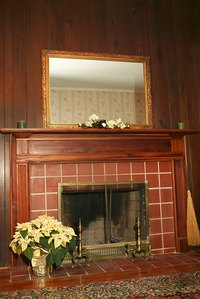 A wooden mantel that ties into the home's overall style is best.