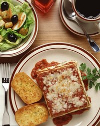 Garlic bread is a traditional accompaniment to lasagna.