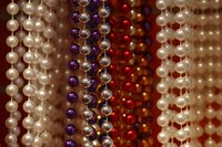 Pearl beads usually come with tiny holes that may require enlarging for some crafts.