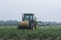 An ATV spray boom is a smaller, simpler version of large-scale agricultural equipment.