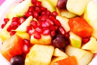 Pomegranate seeds brighten the taste and look of a fruit salad.