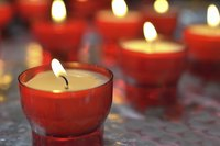 Reuse votive holders and old wax bits to make new candles.