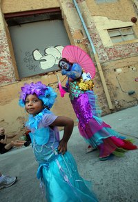 Make kids walking mermaid costumes.