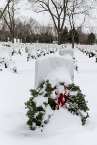 Make an extra wreath for a grave that never has any flowers in honor of Christmas.