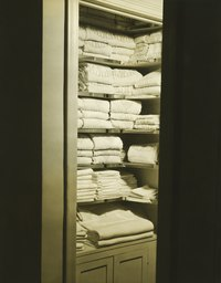 A recessed linen closet adds extra storage for your home.